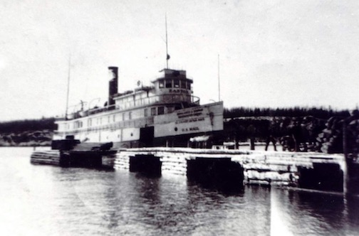 The Easton is docked at the Hovland dock where it has just unloaded oats for the horses in the logging camps.