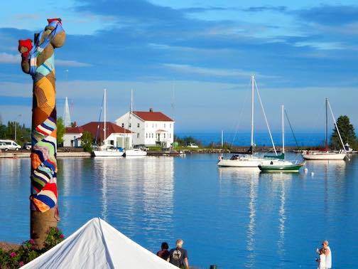 The Grand Marais Arts Festival is held along the harbor in Grand Marais. Northwoods Fiber Guild members yarn-bombed the bear statue a few years ago to celebrate the festival.