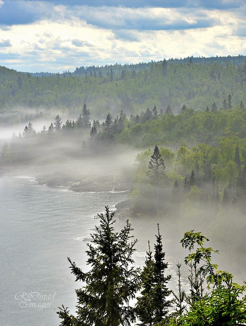 That beautiful view from Split Rock Lighthouse as the fog swept along the shore by Roxanne Distad.