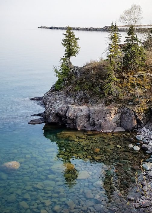 Clear, calm Lake Superior by Thomas Spence.