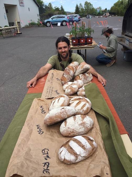 Trevor Huggins sells his wood-fired artisan bread at the Local Food Market on Thursdays.