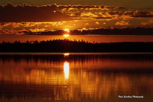 Sunset on Basswood Lake by Paul Sundberg.
