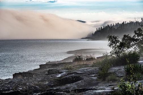 Fog rolling into Grand Marais by Craig Johnson.
