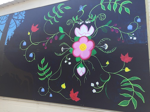 """Imagine,"" the latest community paint-by-number mural has been installed on a wall at Birchbark Books."