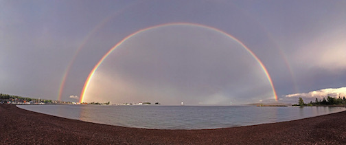 Summer rainbow over Grand Marais by Paul Sundberg.