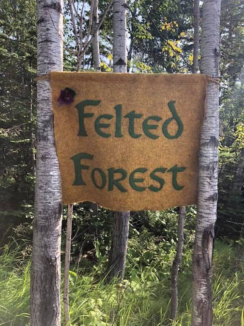 The Felted Forest can be seen on the Sawtooth Elementary Nature Trail in the woods.