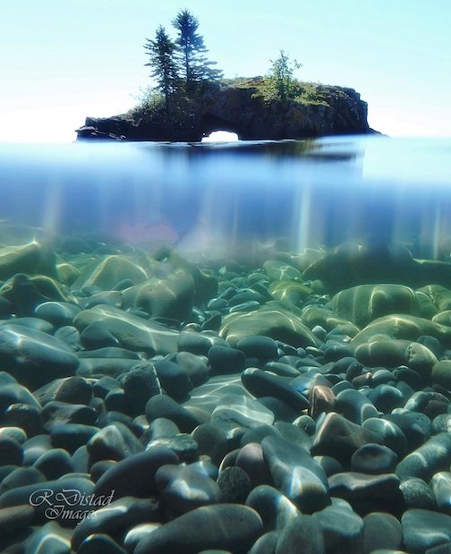Floating along in Lake Superior: Hollow Rock by Roxanne Distad.