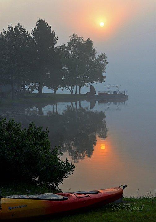 Foggy morning sunrise by Roxanne Distad.