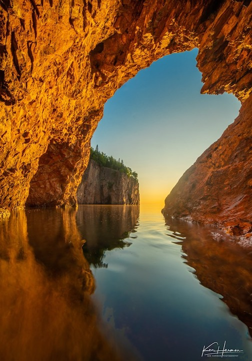 MOring light at a sea cave, North Shore by Ken Harmon.