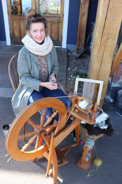 Anna Ruhland at her spinning wheel. The fiber artist will be demonstrating tapestry weaving at North House Folk School Thursday through Sunday and teaching a mini-class Saturday at 10 a.m.