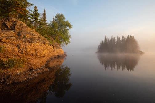 Paddling on an inland lake by Benjamin Olson.