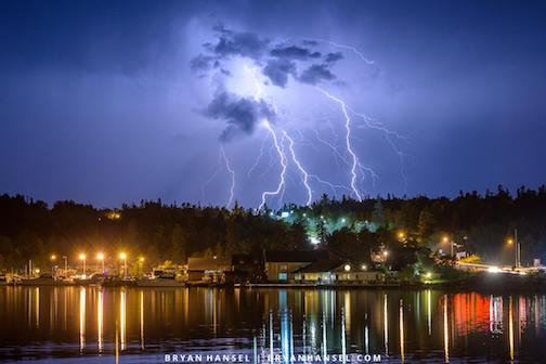 A little lightning over Grand Marais by Bryan Hansel.