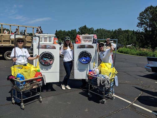 Orphan Sock Dispensers: Terry and Lori Backlund, who own Squiggs Laundromat. won Funniest Float at the Fisherman's Picnic Parade. They dressed up as dryers and dropped occasionally dropped orphan socks in front of people watching the parade.