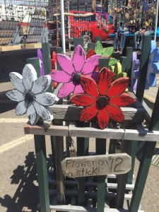 Colorful garden art by Papa's Hands is one of the featured booths at the Cook County Market.
