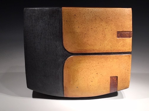 "Dan & Lee Ross have their studio in Hovland. They will exhibit sculptures (stone and clay), mono prints and fused glass. This ceramic piece is entitled ""Laurentian Divide."""