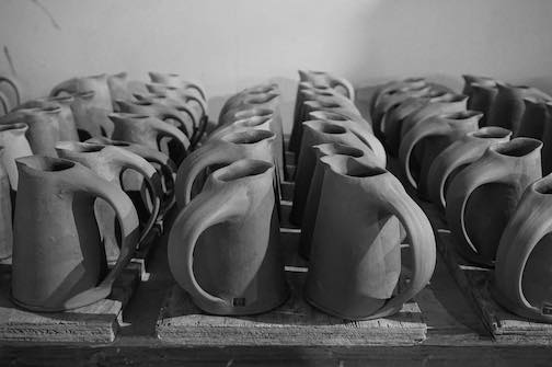Jason Trebs is on the Fall Studio Tour. His studio is located near Schroeder. He posted this photo of syrup pitchers lined up and ready of firing the other day.