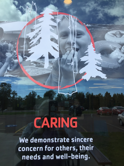One of the photo collages on the entrance windows at the YMCA in Grand Marais. Artwork by Linda Ricklefs Baudry, photos by Tim Young.