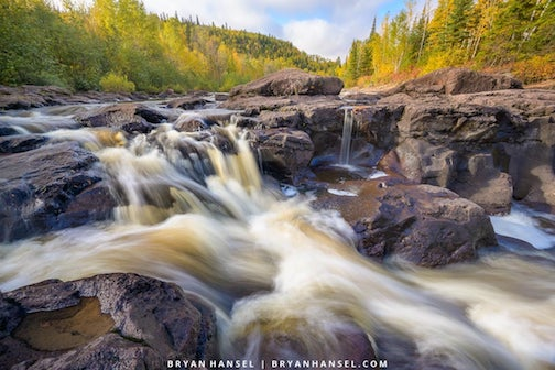 Fall color rages over the Temperance River by Bryan Hansel.
