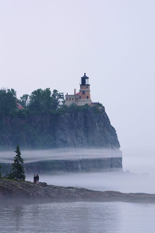 Split Rock Lighthouse with fog ring by Randy Quast.