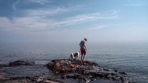 """The Dog and the Boy–Lake Superior"" by Ann Berget, is one of the photographs in the new exhibit at the Johnson Heritage Post."