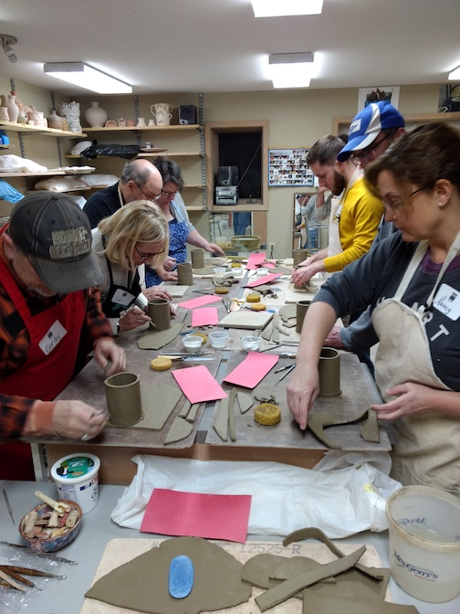 """Participants in """"A Night Out in the Pottery Studio"""" work on a handbuilt mug during last year's event."""