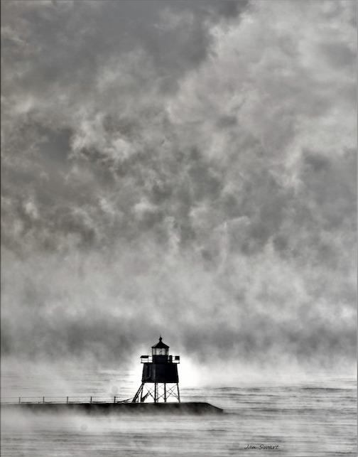 Two Harbors under sea smoke by Jan Swart.