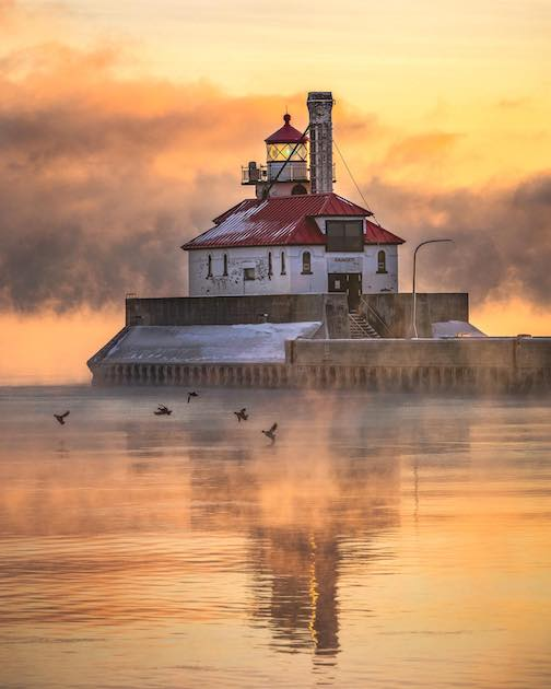 A cold sea smoke morning in Duluth by John Keefover.