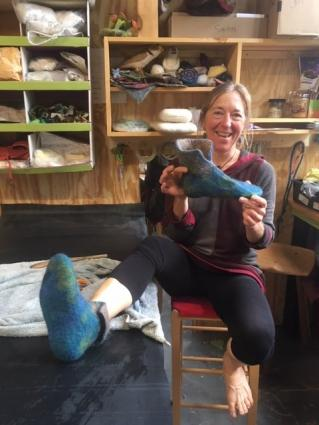 Elise Kyllo shows off a felted slipper she made during the filming of Making It: Crafting a Life. The program will be aired on WDSE on Thursday at 8 p.m.