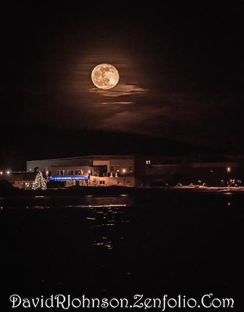 Last night's Wolf Moon over Grand Marais by David Johnson.