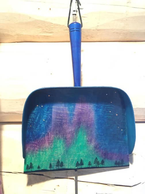 "One of the many dustpans on view in Marybeth Garmoe's exhibit at the Johnson Heritage Post, ""Wood Swept."""