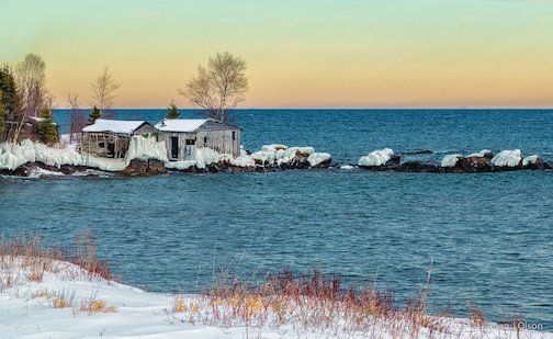 Old fishing shacks near Grand Portage by Donald Jay Olson.