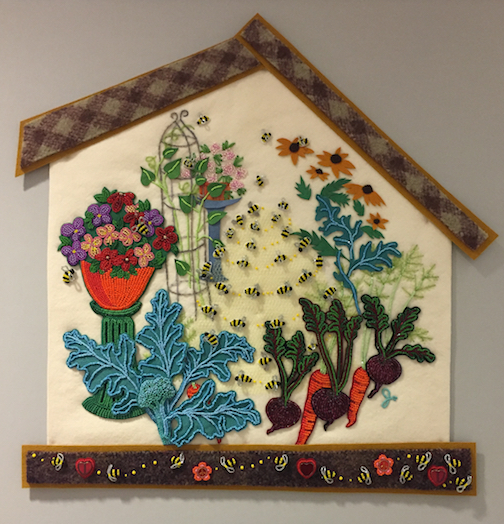 """The Bees live in the Middle,"" bead painting by Jo Wood, is currently on exhibit at the Cook County Courthouse."