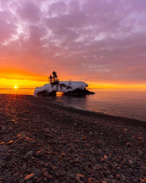 Sunrise at Hollow Rock by Martin Jr. Ramirez.