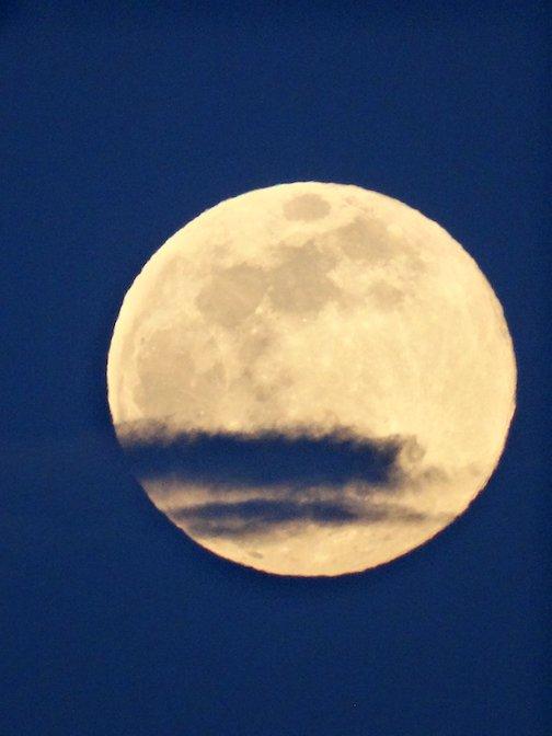 Full moon from South Dakota by Amanda Takes War Bonnett.