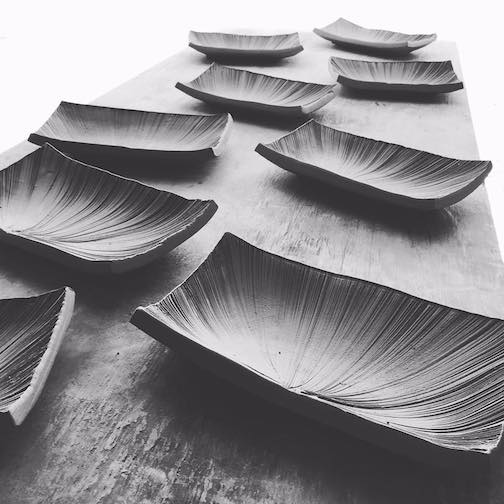 Trays by Jason Trebs drying in the studio. They will be glazed and fired and offered online.