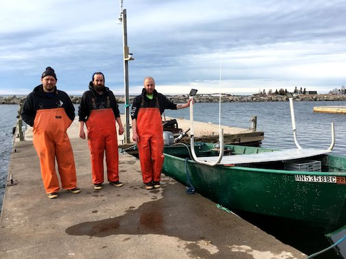 The start of fishing season. Eric Brisson, Tyler Smith and Zach Smith are ready for their first catch of the season. Photo courtesy of North House Folk School.