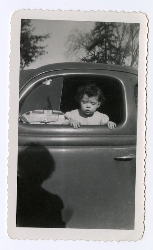 "Toddler in the Window is one of the photographs in the National Museum of American History's ""Window Views"" virtual exhibit."