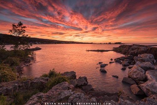 Good morning! Lake Superior and the Grand Marais Harbor by Bryan Hansel.