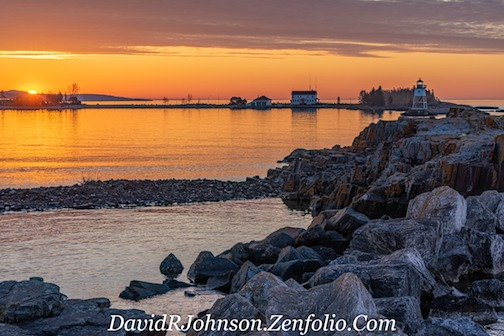 Wonderful golden sunrise in Grand Marais by David Johnson.