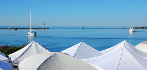 We won't see these white tents on the harbor this summer. but the Grand Marais Art Colony has posted links to the artists who were juried into the arts festival.