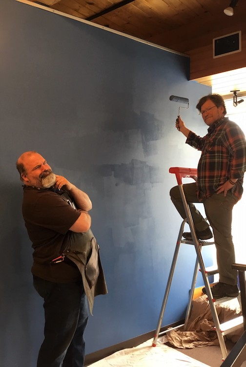 Neil Sherman, left, inspects Robb Fortin's wall painting skills as Fortin paints a wall at Sivertson Gallery Lake Superior Blue.