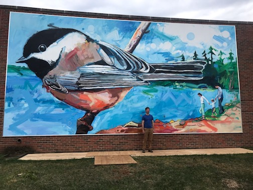 Adam Swanson's Chickadee, a new mural at the Grand Rapids Area Library.