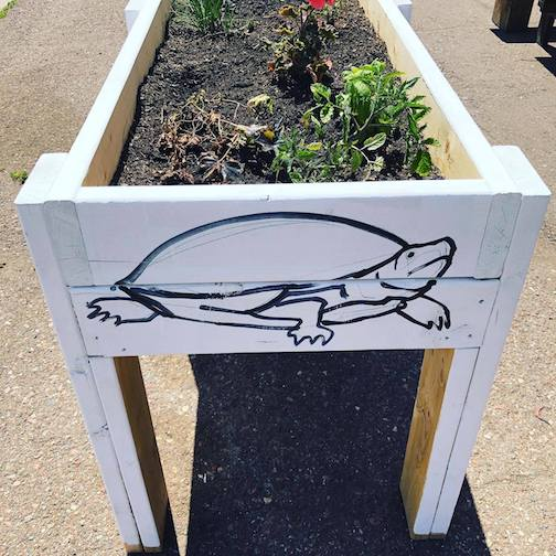 One of Timothy Young's design on the Art Colony's plant. boxes outside their new building at 17 W. Hwy. 61, The turtle and other creatures on the boxes will be painted by youth this summer.