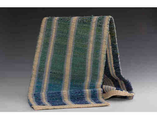 """Flowing Waters,"" a wood runner by weaver Julie Arthur is one of the items available through the online auction."