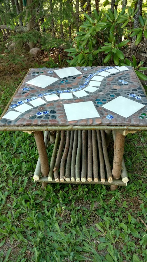 Table with stone, tile and willow by Paula Sundet Wolf.