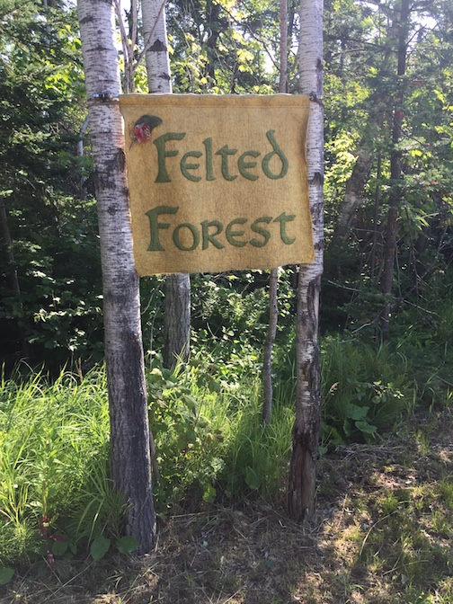 The entrance to the Felted Forest  from 5th Street is marked by a felted sign.