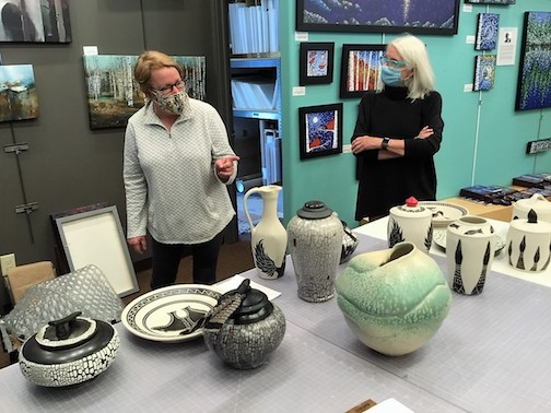 Potter Maggie Anderson, left, describes the process of making her work to Sivertson Gallery owner, Jan Sivertson.