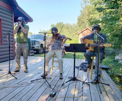 Singer/songwriter Jerry Vandiver (guitar and vocals), Catlin Evanson (fiddle and vocals) and Jay Gustafson (harmonica) played on the back deck of WTIP Community Radio for The Roadhouse.