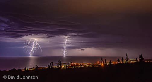 Awesome storm rolls past Grand Marais by David Johnson.