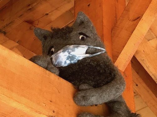 Felter Elise Kyllo added a mask to this little one, perched on the rafters in the timber frame structure at one of the entrances to the Felted Forest.